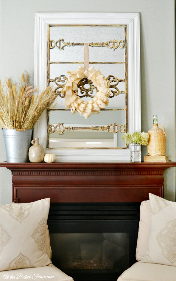 Fall mantel with corn husk wreath atthepicketfence.com