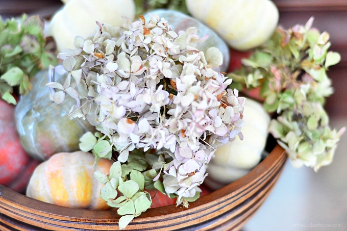 bowl of pumpkins and dried hydrangeas