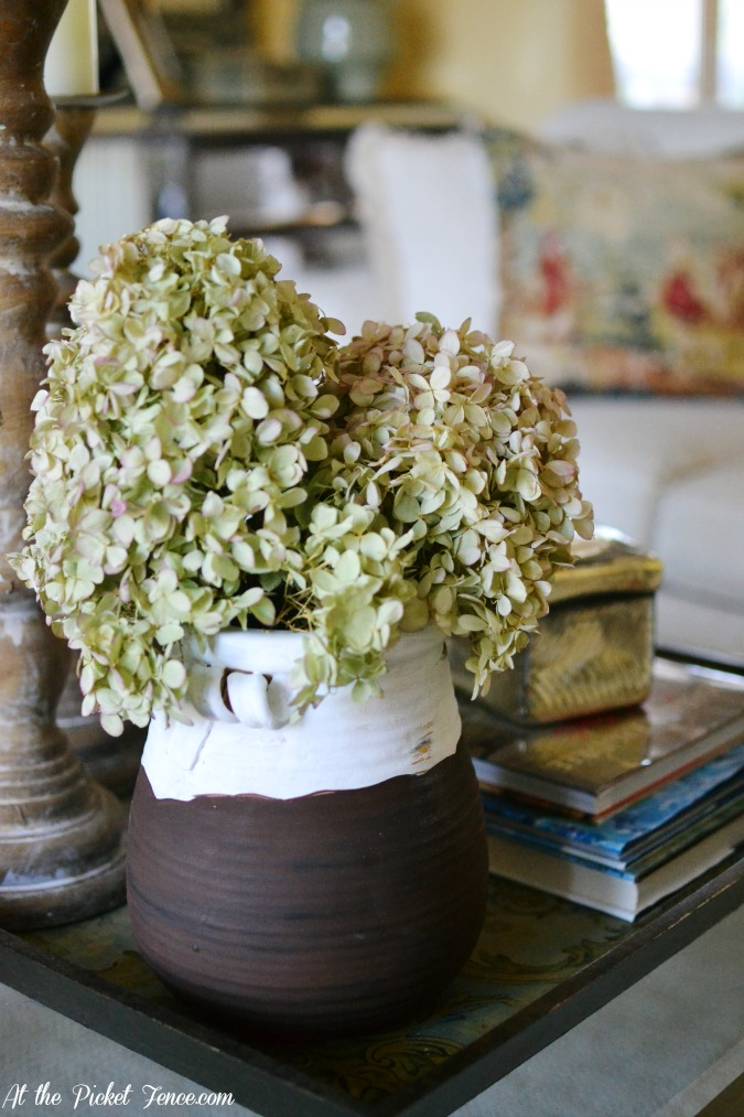 dried hydrangeas on olive jar atthepicketfence.com