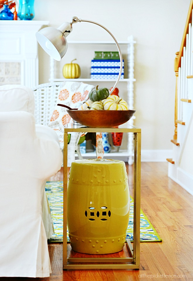 garden stool side table with pumpkin filled dough bowl