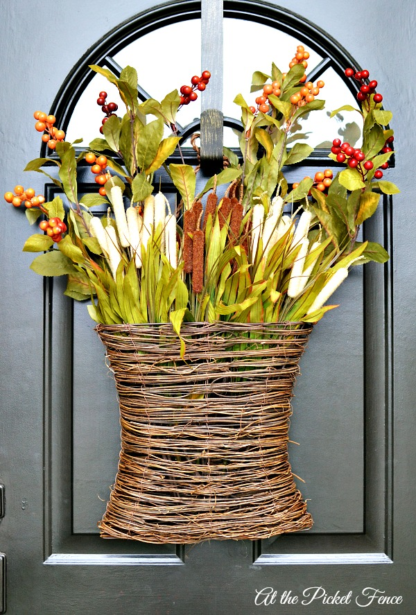 hanging fall basket on front door from atthepicketfence.com