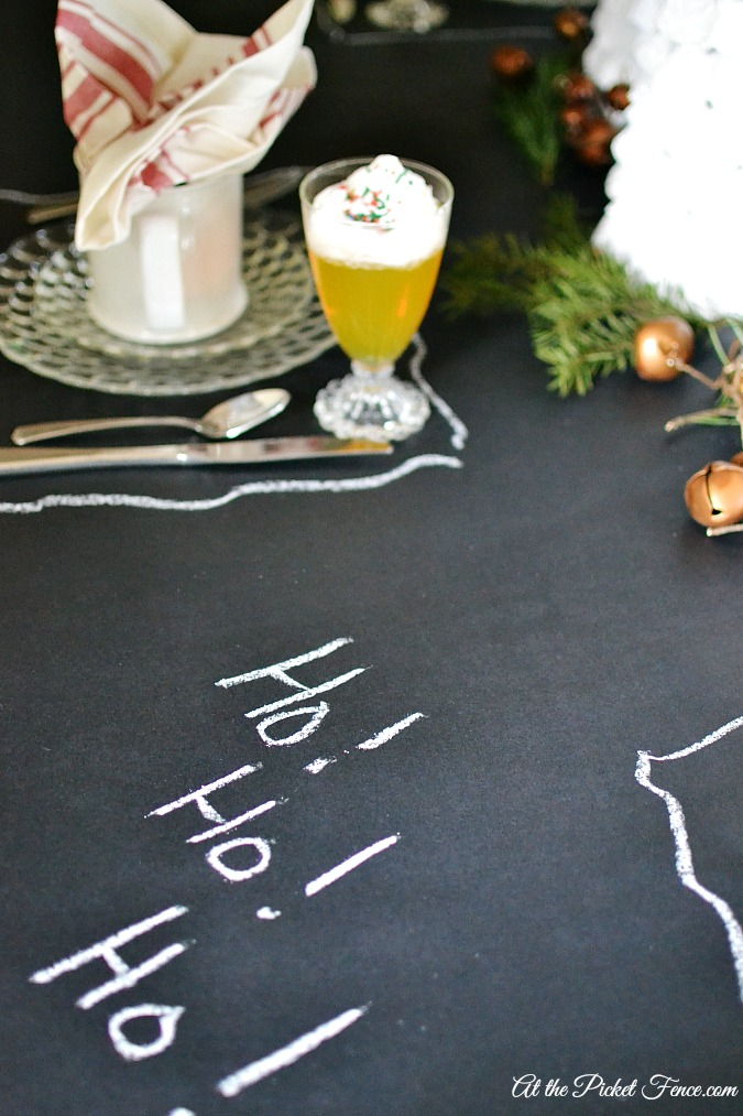 Chalkboard paper tablecloth for Christmas breakfast atthepicketfence.com