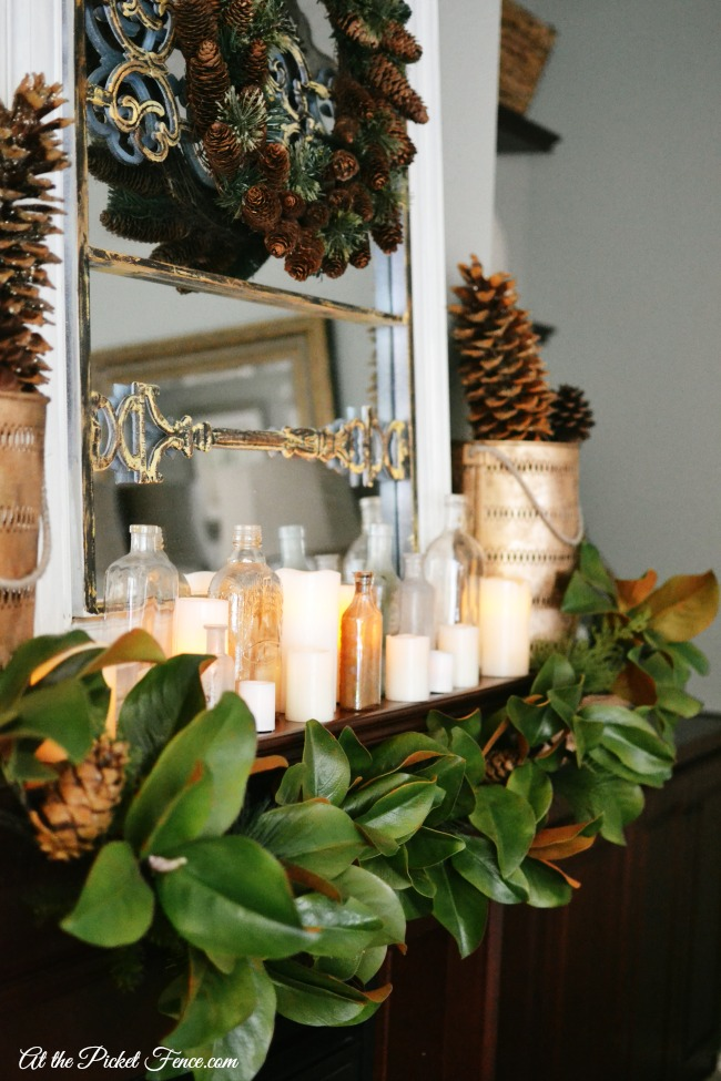 christmas mantel with magnolia garland atthepicketfencecom
