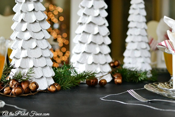 Christmas trees with jingle bell garland centerpiece atthepicketfence.com