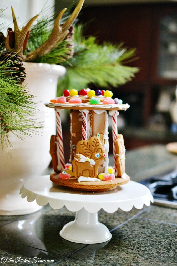 gingerbread carousel on cake stand atthepicketfence.com