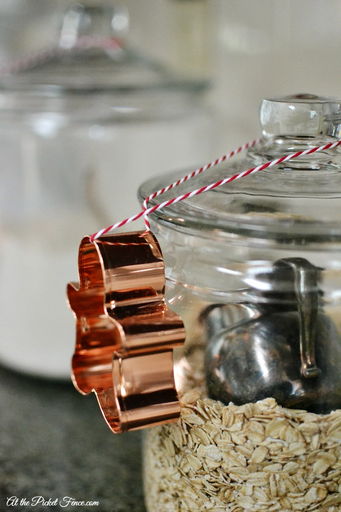 gingerbread cookie cutter tied onto canister on kitchen counter