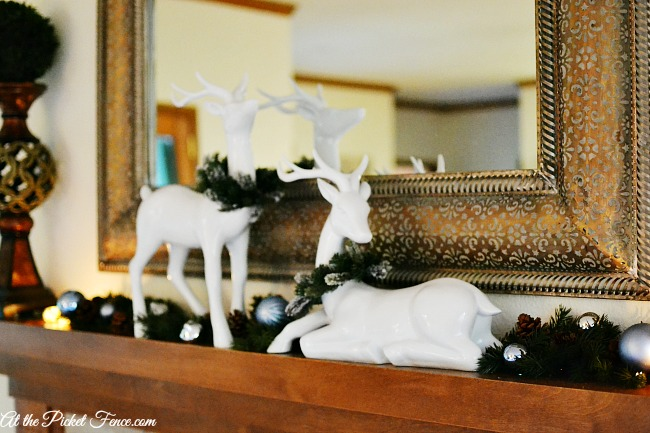 white reindeer on mantel atthepicketfence.com