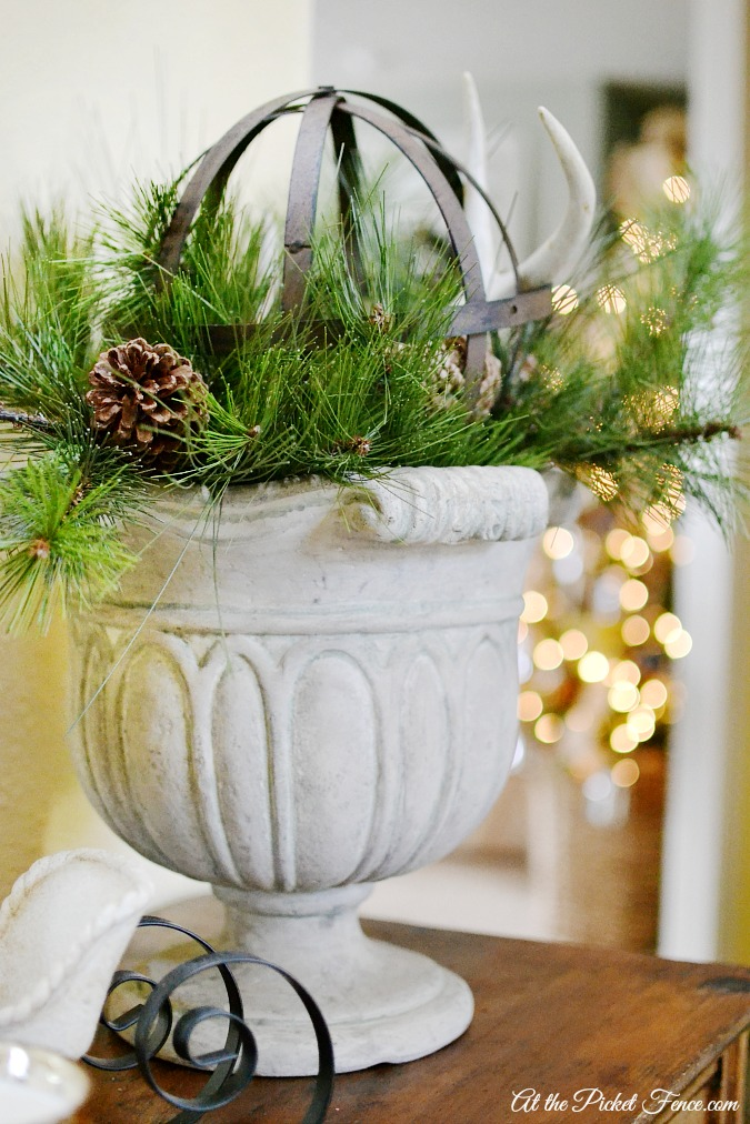 Christmas arrangement on entry table atthepicketfence.com