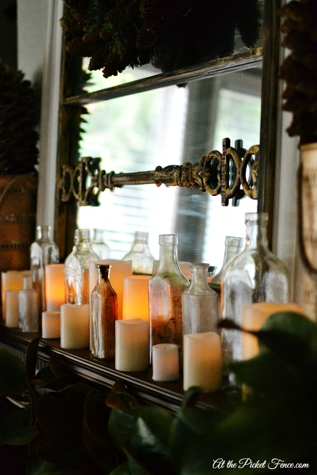 bottle and candles Christmas winter mantel atthepicketfence.com