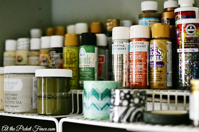 organizing craft paint in cabinet atthepicketfence.com
