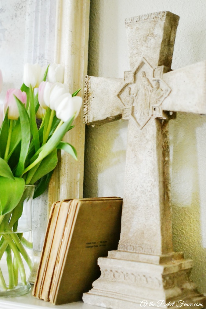 Spring mantel decorating with a stone cross atthepicketfence.com