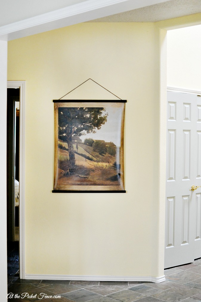 landscape canvas hanging in hallway