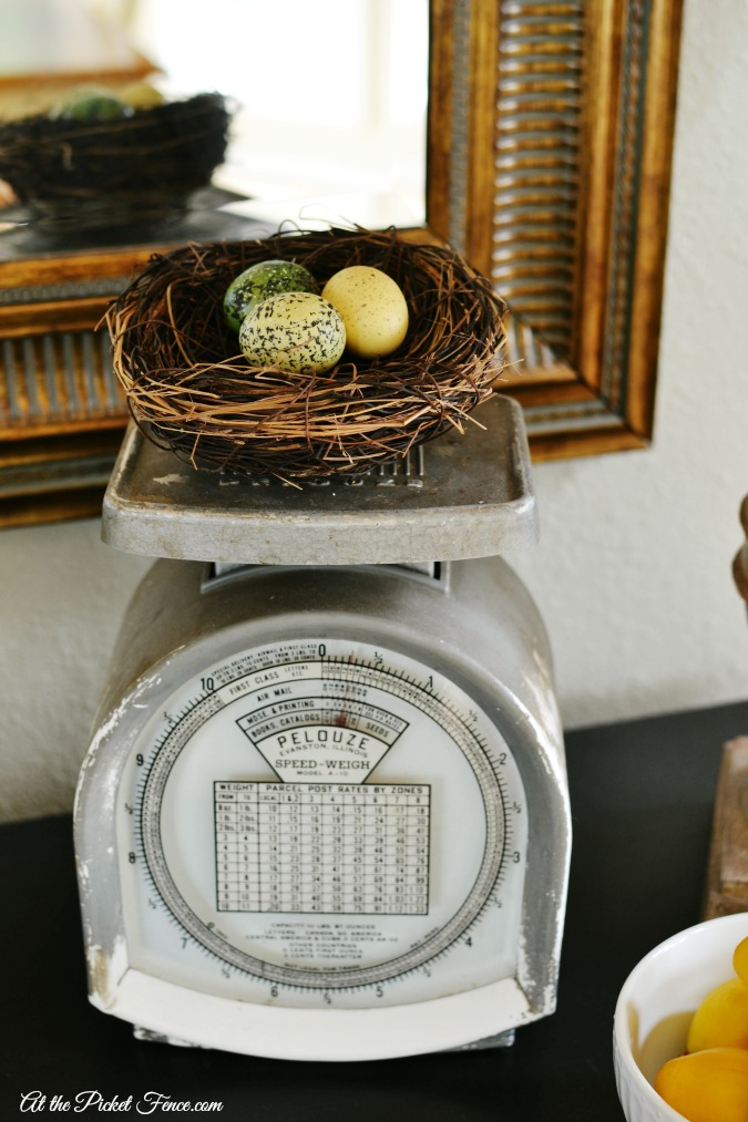 simple spring decor idea birds nest on vintage scale
