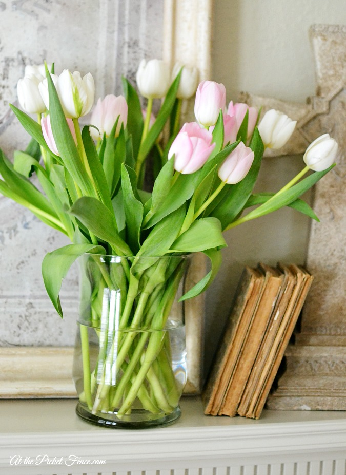 spring mantel decor with tulips atthepicketfence.com