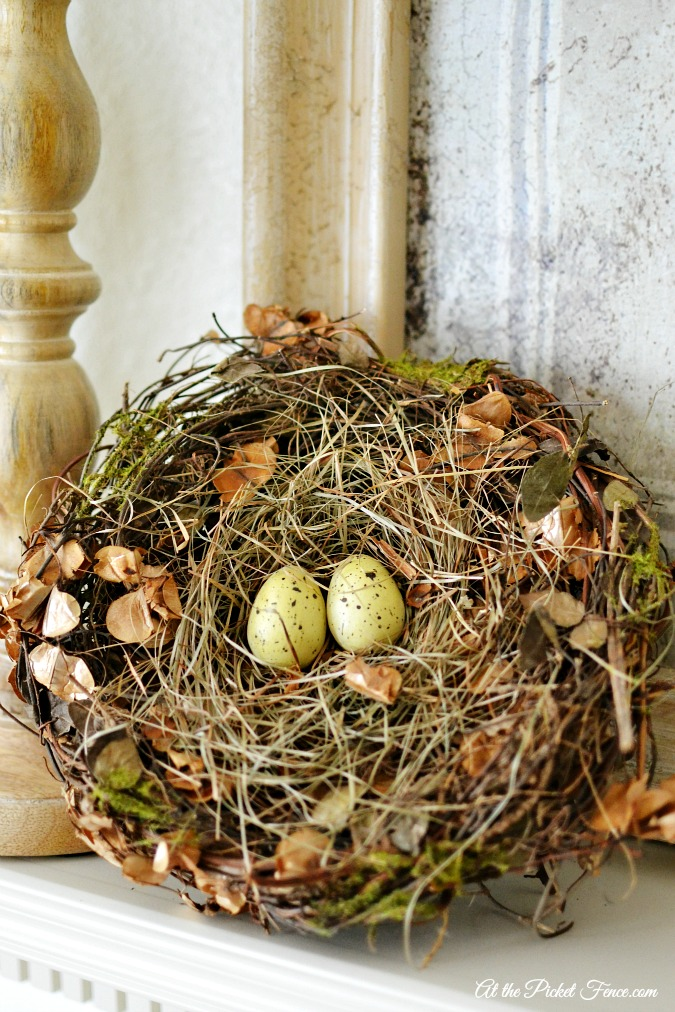 spring mantel decorating with birds nest atthepicketfence.com