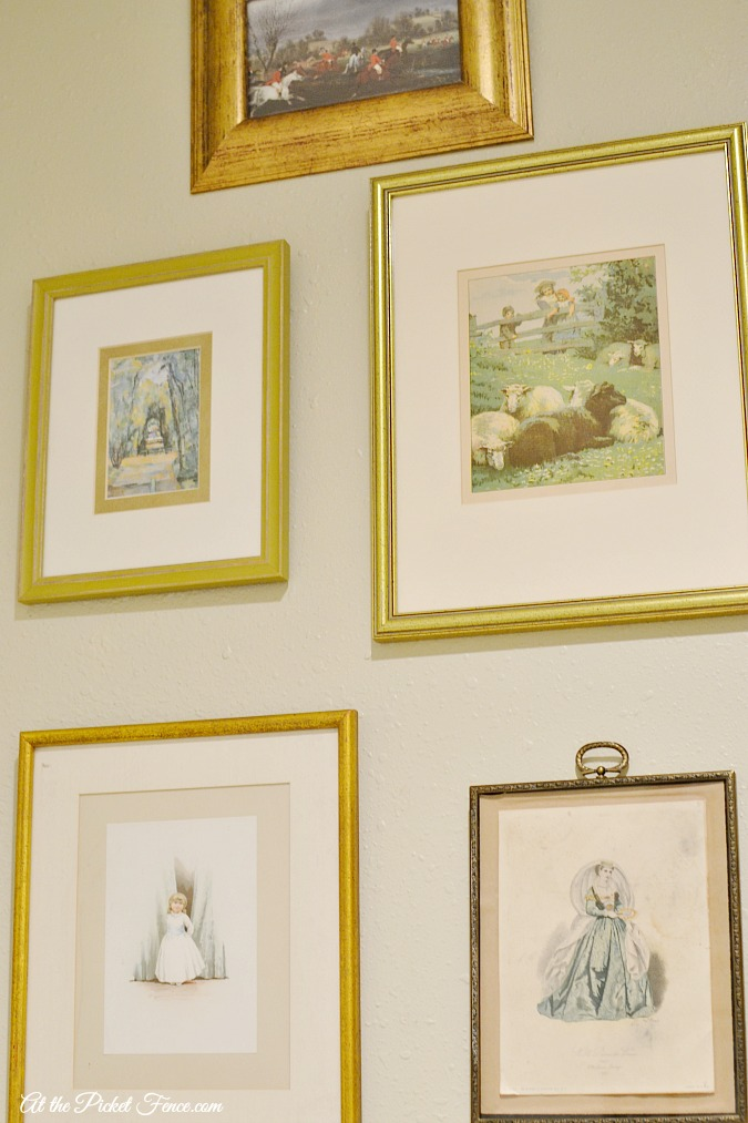 gallery wall of vintage prints atthepicketfence.com