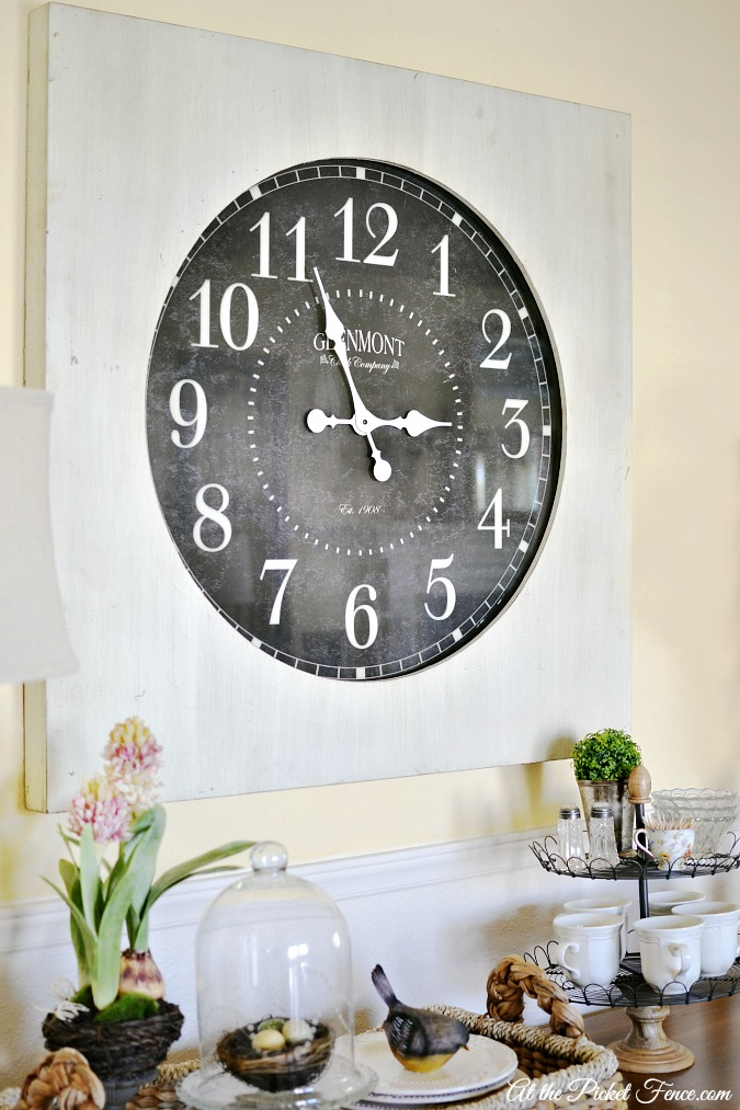 oversized clock above buffet table atthepicketfence.com