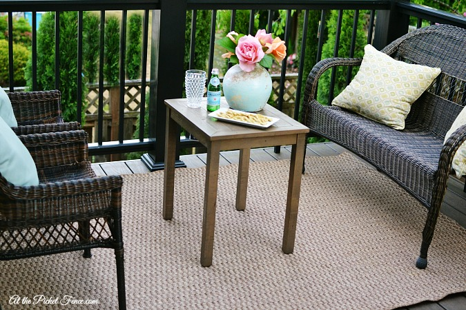 Outdoor seating area on a deck atthepicketfence.com