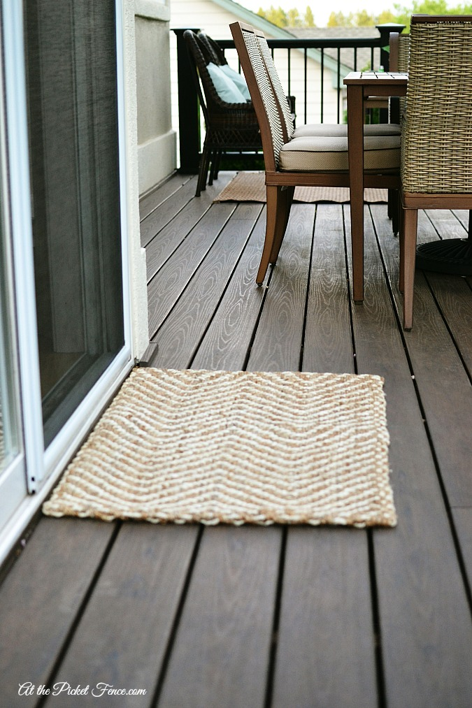 woven rug on the deck atthepicketfence.com