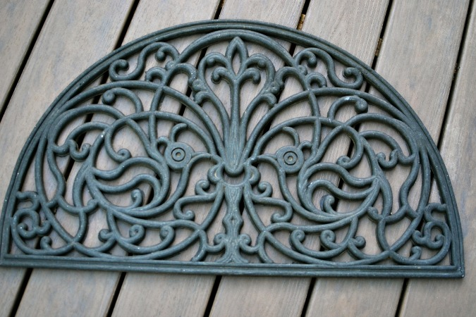 black scrollwork outdoor mat