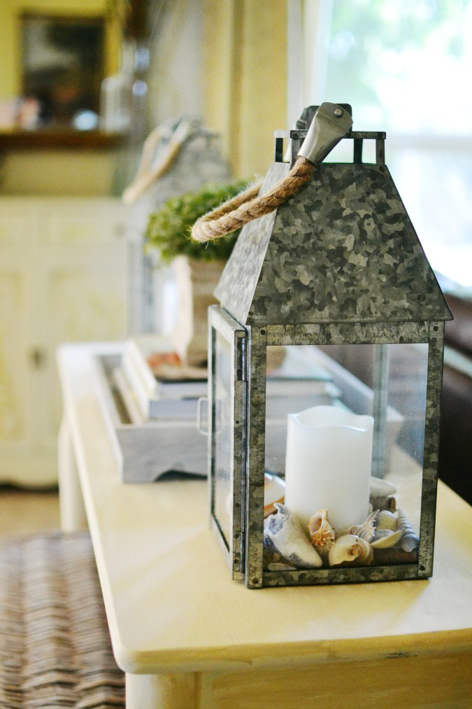 metal lantern with seashells