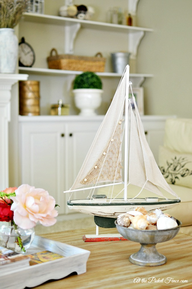 wood sailboat on coffee table
