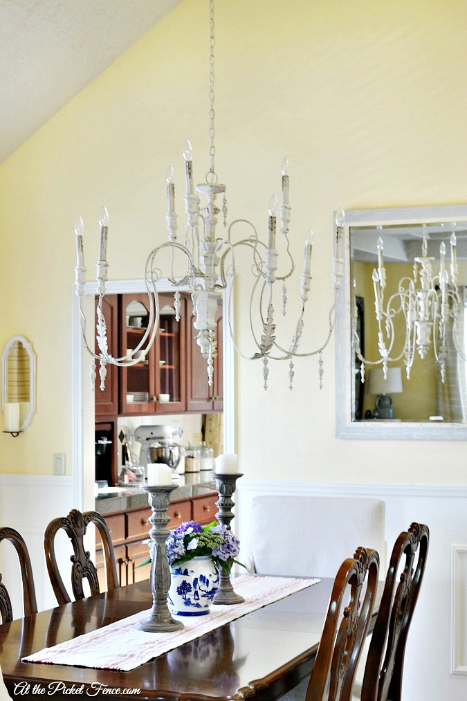 French Country dining room with white chandelier atthepicketfence