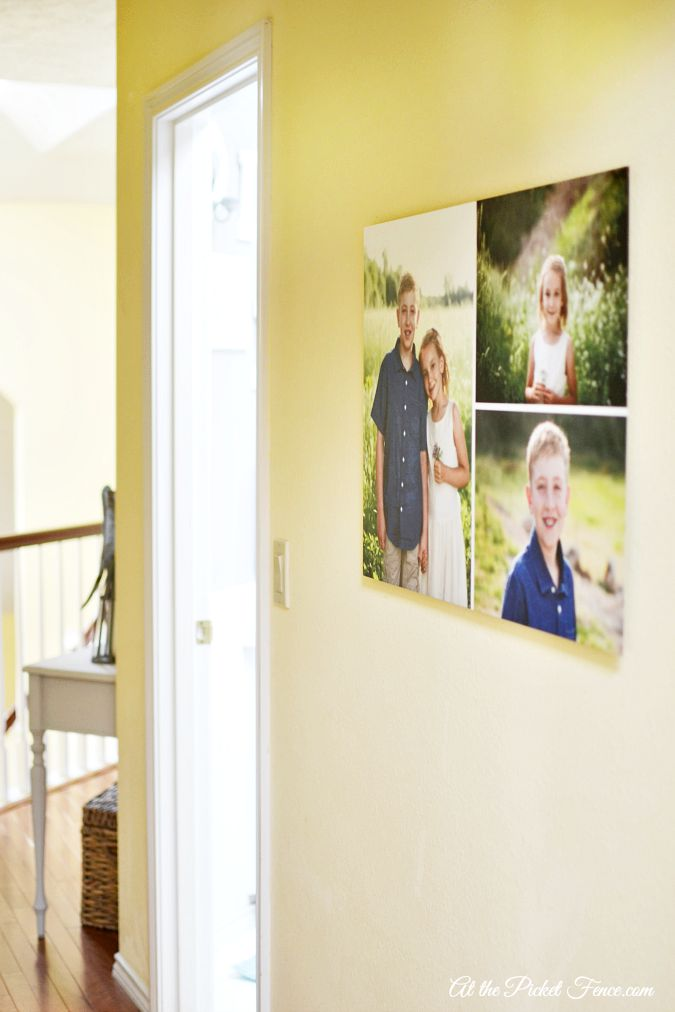Gallery wall photos in hallway atthepicketfence.com