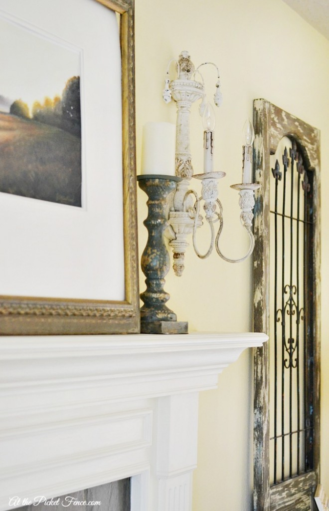 french country style sconce and mantel decor