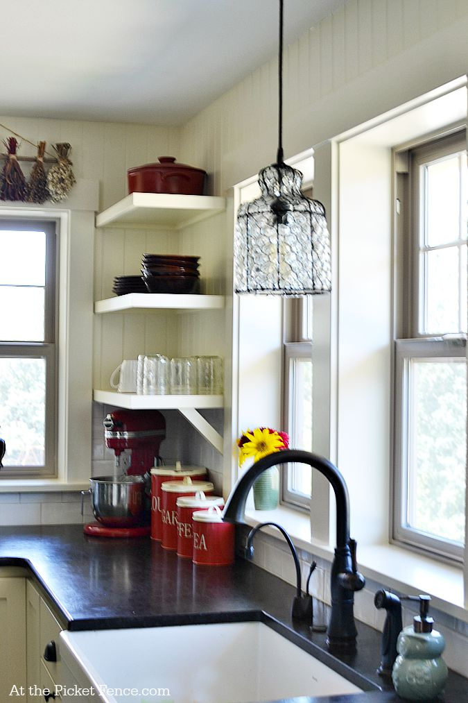 Farmhouse Kitchen sink with pendant light fixture atthepicketfence.com