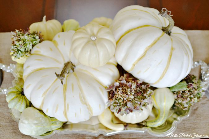 White pumpkin and hydrangea centerpiece atthepicketfence.com