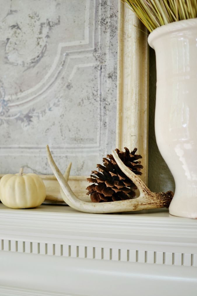 antler and pine cone on mantel fall decor atthepicketfence.com