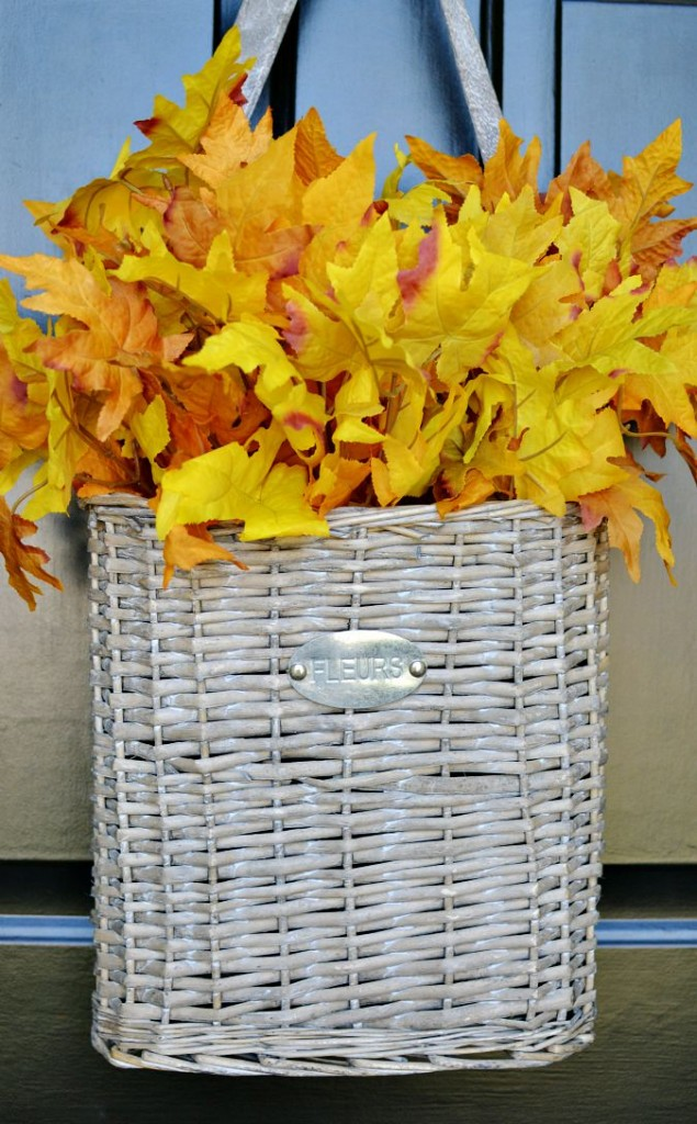 basket with fall leaves on door