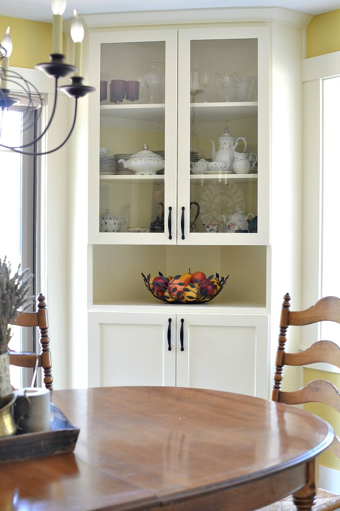 Before and after dining room makeover at the picket fence for Built in dining room cabinet designs