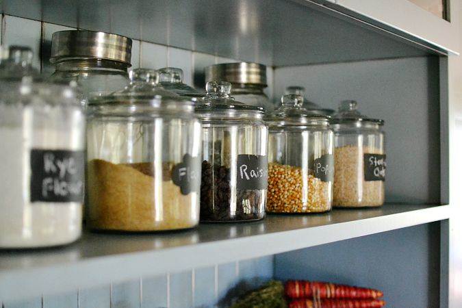 chalkboard canisters on shelf in kitchen