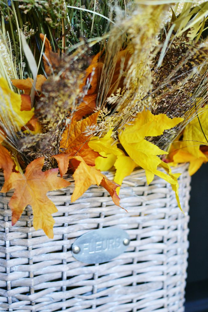 fall foliage in gray basket