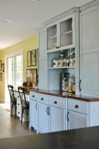 kitchen cabinets built to look like furniture atthepicketfence.com