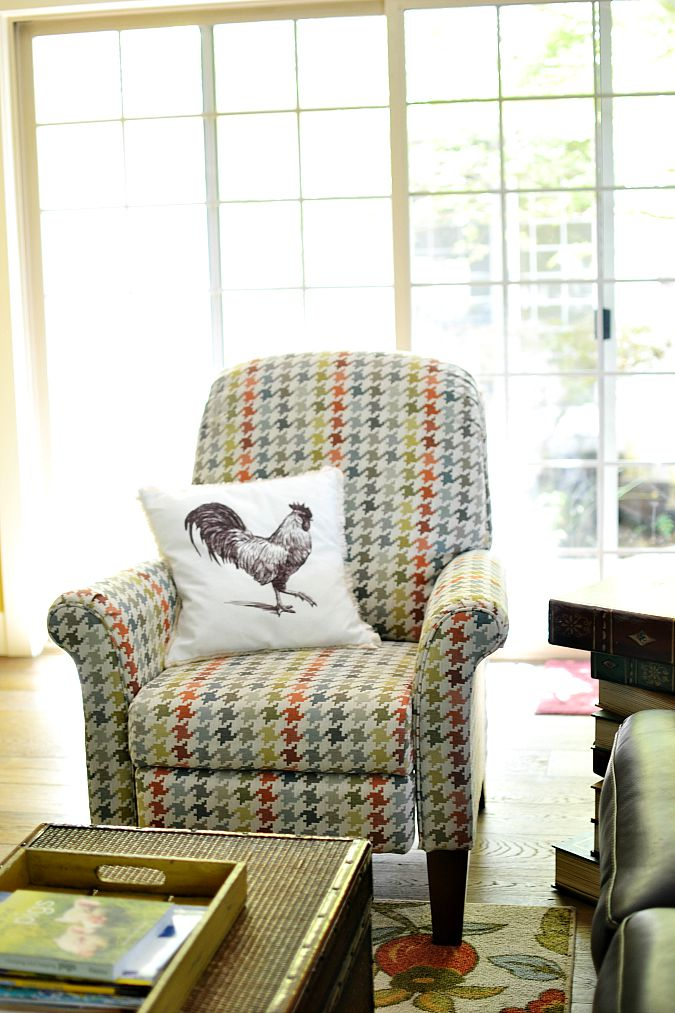 patterned chair and rooster pillow