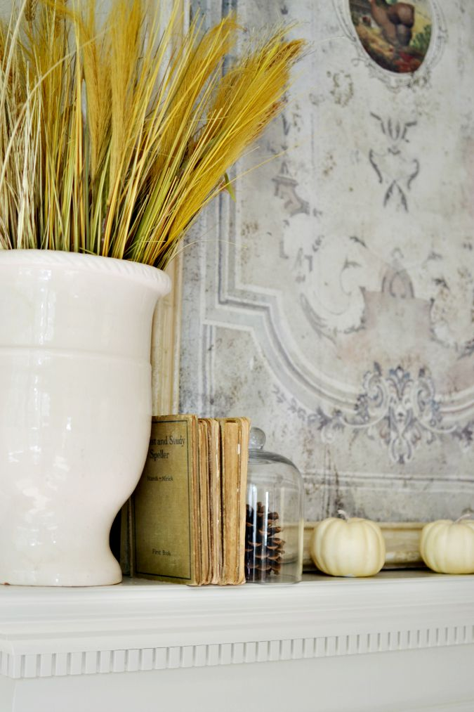 simple fall mantel decor with vintage books atthepicketfence.com