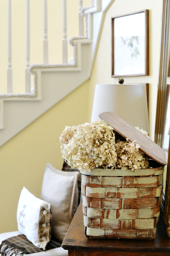 vintage picnic basket with dried hydrangeas atthepicketfence.com