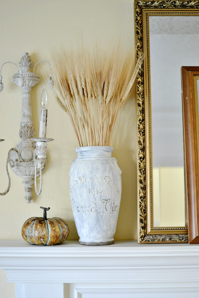 wheat in urn on fall mantel atthepicketfence.com