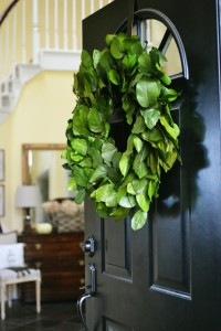 green wreath on black front door