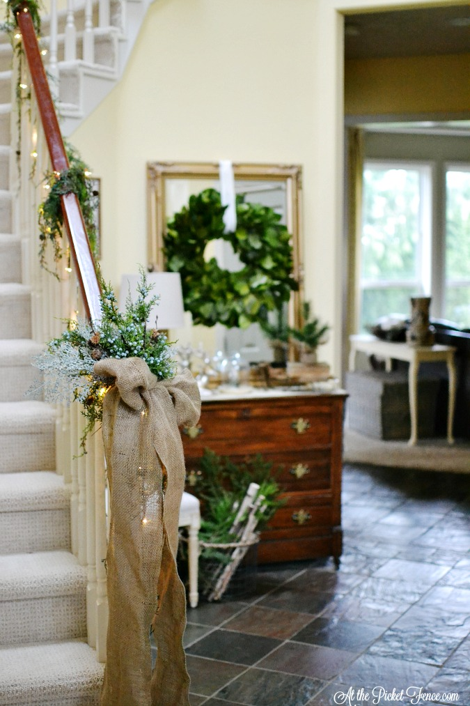 Christmas entry with garland on staircase