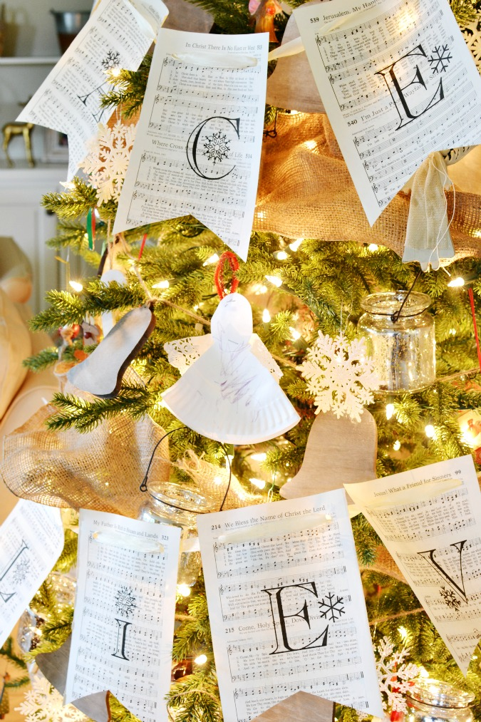 Vintage music sheet banner on Christmas tree atthepicketfence.com