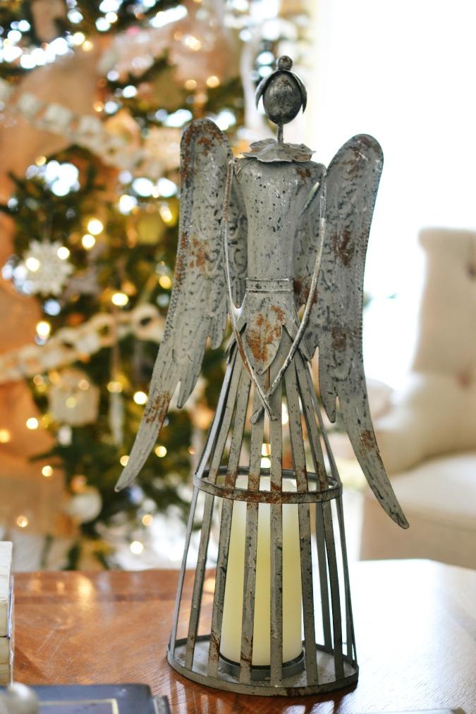 metal santos doll angel atthepicketfence.com