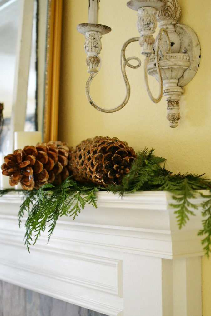 pine cones and fresh greenery on mantel