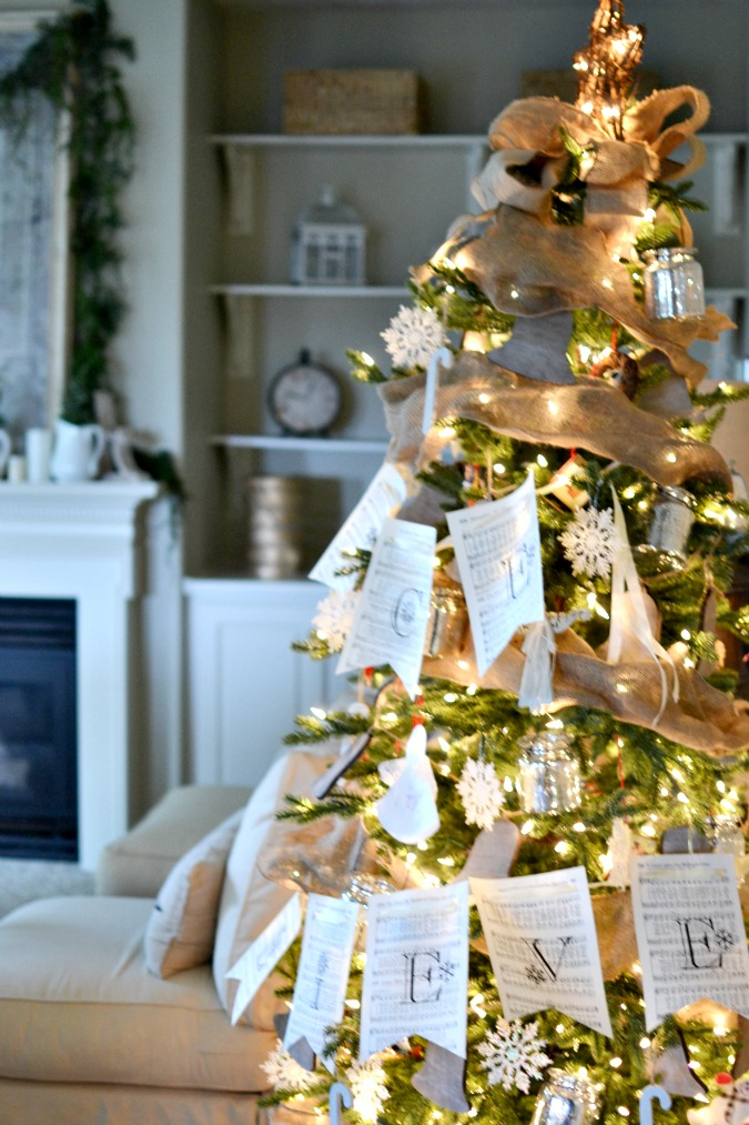 simply decorated Christmas tree with paper banner