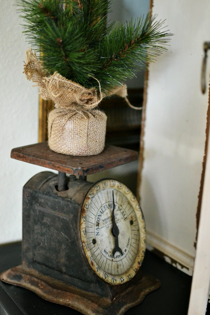 vintage scale with pine tree on top atthepicketfence.com