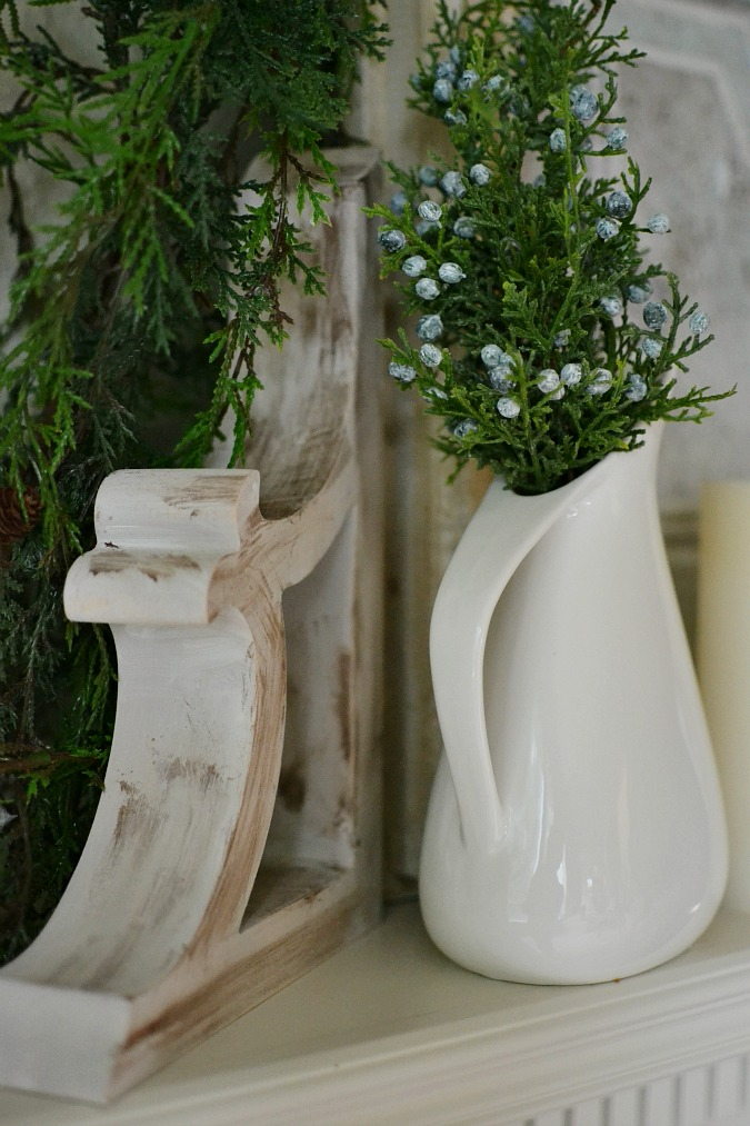 wood corbel and white pitcher on mantel