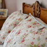 cabbage rose pillowcases on oak bed